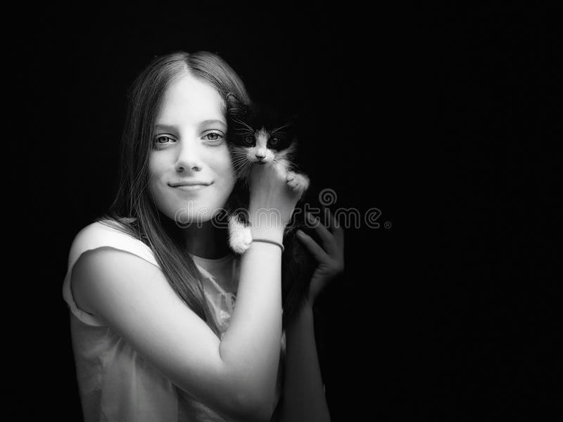 Young girl and her kitty black and white portrait stock photography