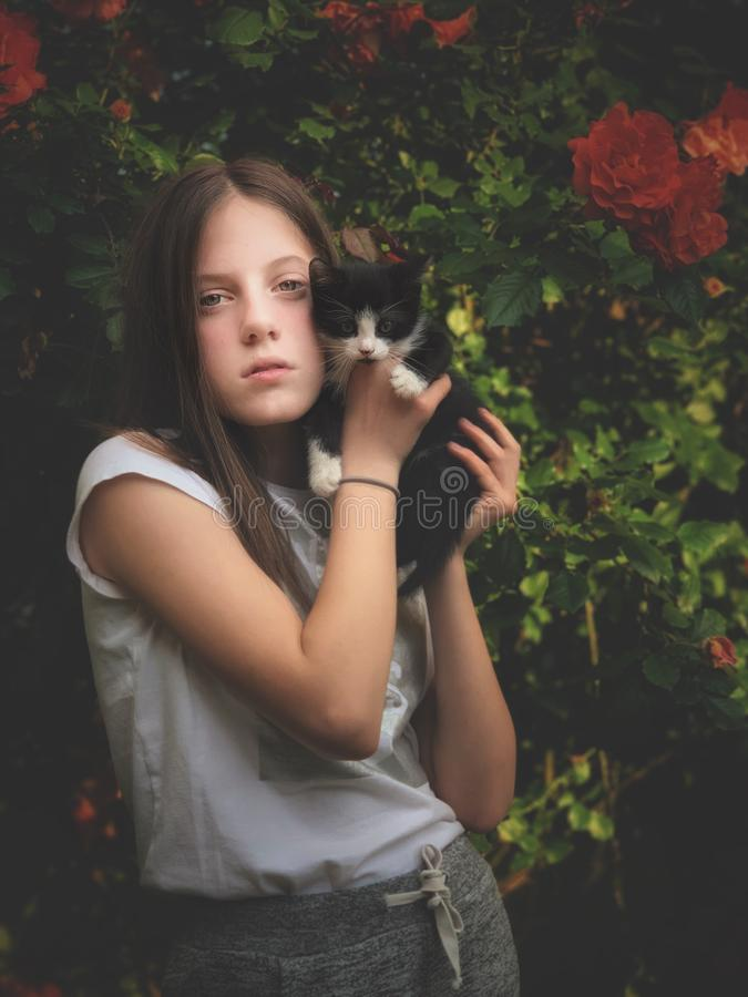 Young girl and her kitty royalty free stock image