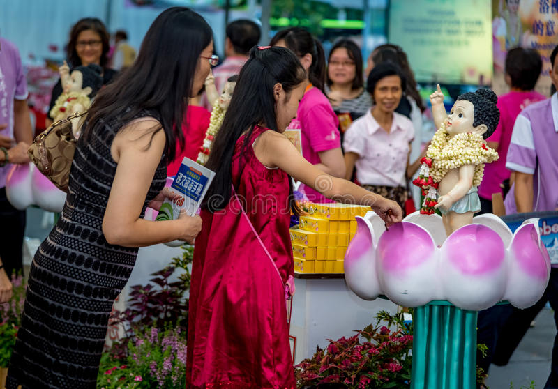 Young Girl and Her Mother Bathing the Buddha During Vesak Day royalty free stock photos