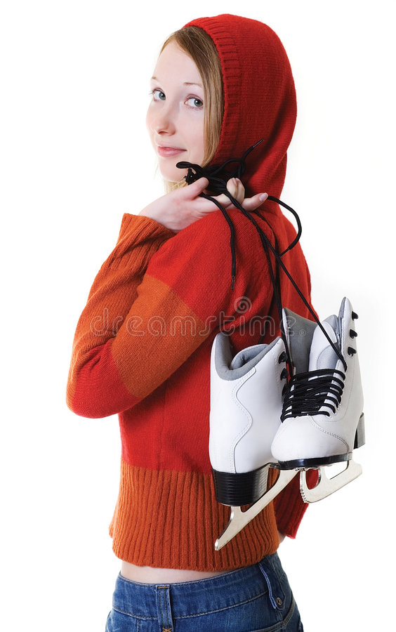 Young girl and her skates royalty free stock image