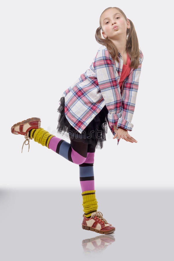 Young girl in hipster style, with ponytails royalty free stock photography