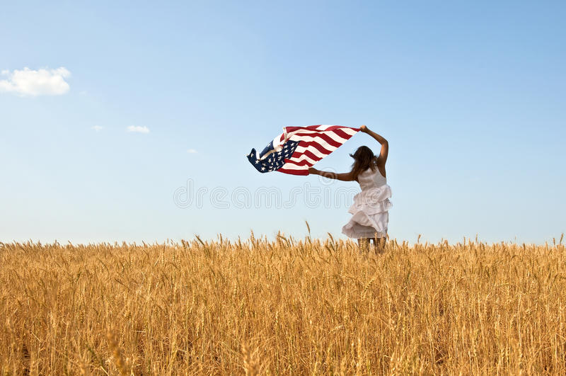 Young girl holding an American flag stock photos