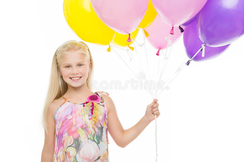 Young girl holding balloons stock photography