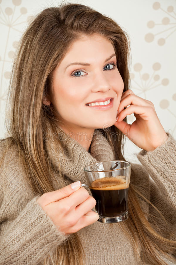 Young Girl Holding A Cup Of Coffee And Smiling Royalty Free Stock Photography