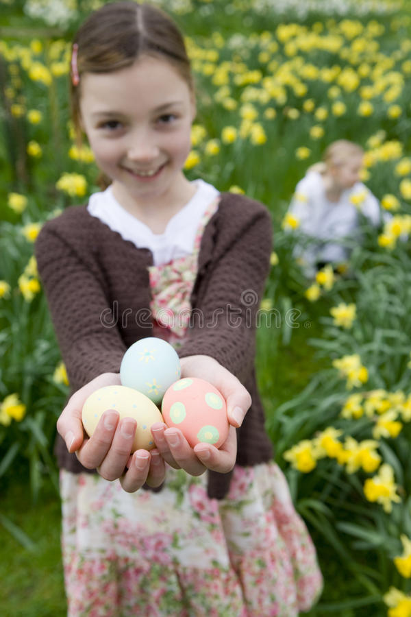 Young girl holding decorated Easter eggs stock photo