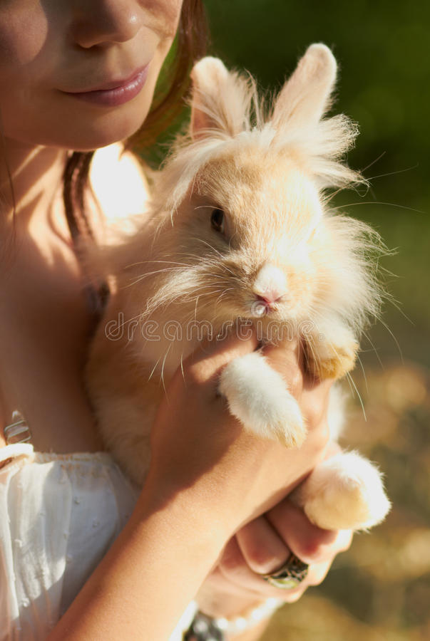 Download Young Girl Holding A Decorative Bunny Royalty Free Stock Photo - Image: 25346115