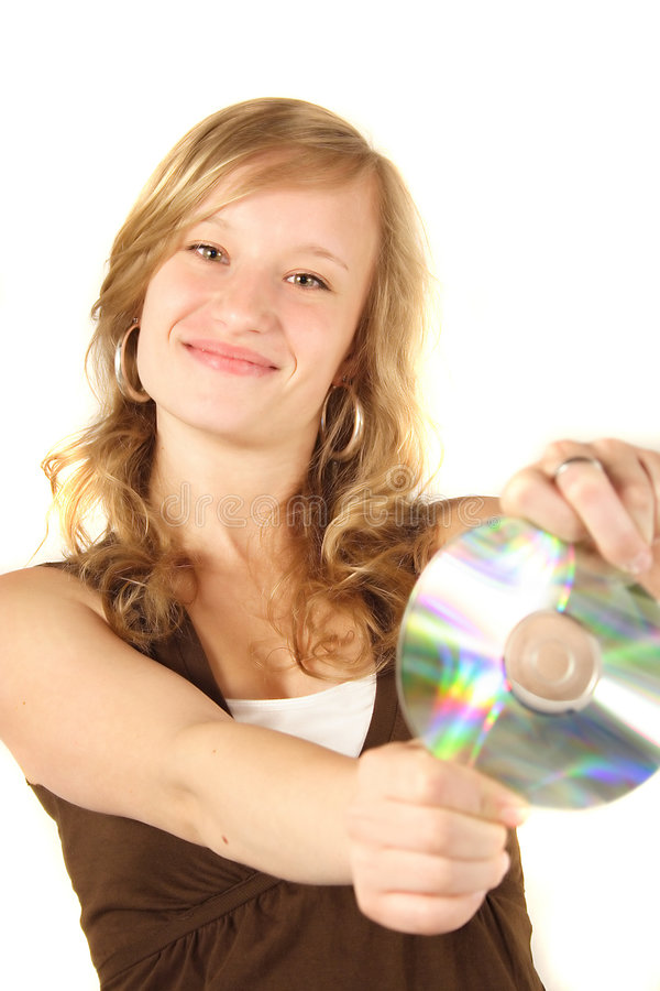 Young Girl Holding a DVD. An attractive young adult woman holding a dvd stock images