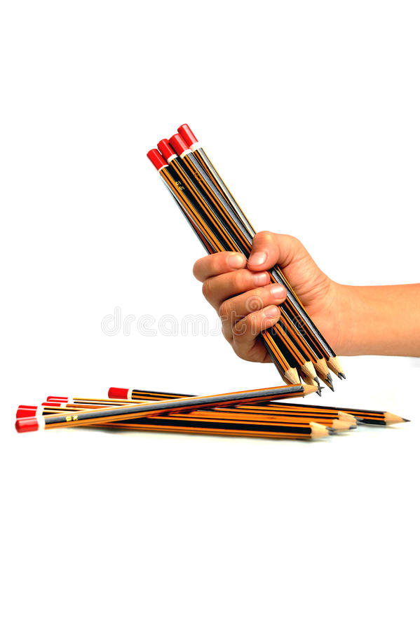 Young girl holding few pencils royalty free stock photography
