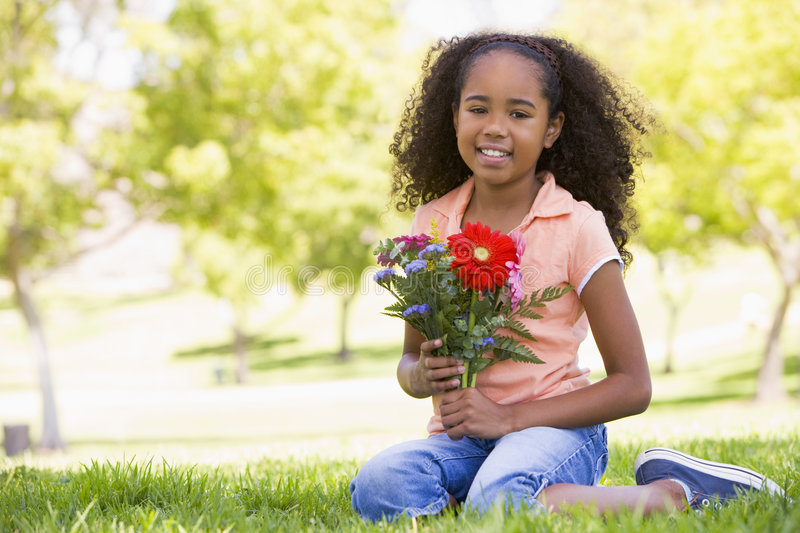 Download Young girl holding flowers stock image. Image of holding - 5944335