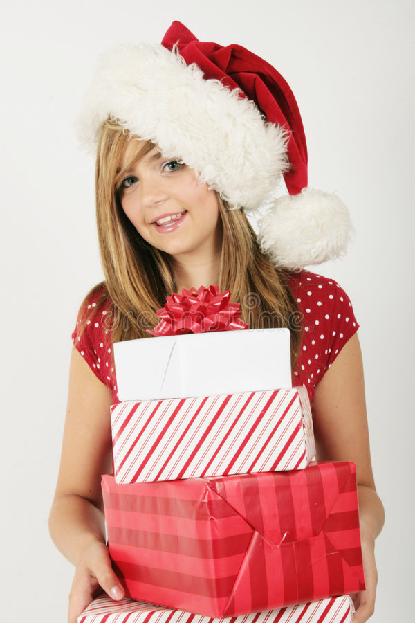 Young girl holding gifts stock photo