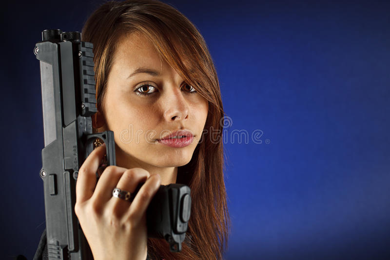Young girl holding gun royalty free stock photo