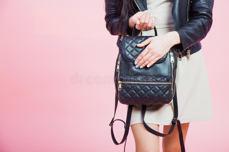 Young girl holding leather bag with nails manicure royalty free stock images