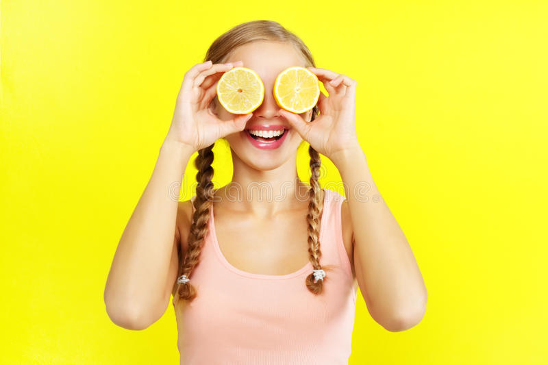 Young girl holding lemons royalty free stock photography