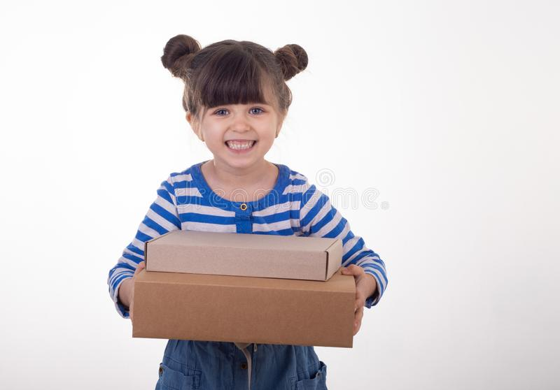 Young girl holding pyramid of carton boxes. royalty free stock image