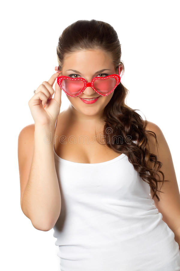 Young girl is holding red sunglasses. Glamour portrait of young girl with red lips and sunglasses isolated over white royalty free stock images