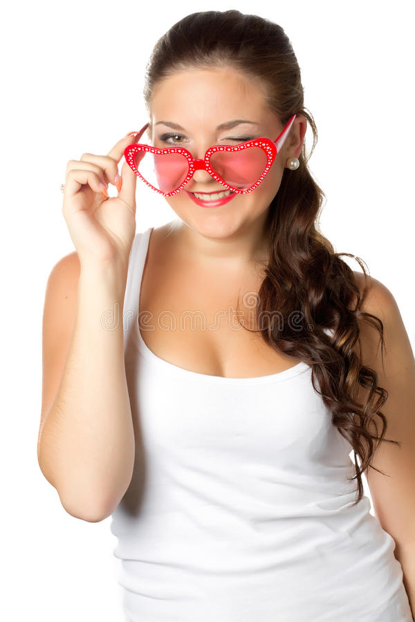Young girl is holding red sunglasses. Glamour portrait of young girl with red lips and sunglasses isolated over white royalty free stock photography