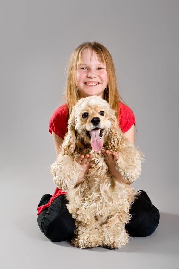 Young girl holding spaniel stock photos