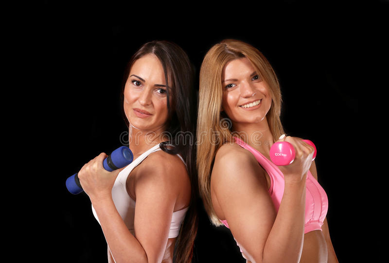 Young girl holding sports weights stock photography