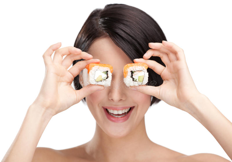 Download Young Girl Holding Sushi And Smiling Stock Photo - Image: 24919260