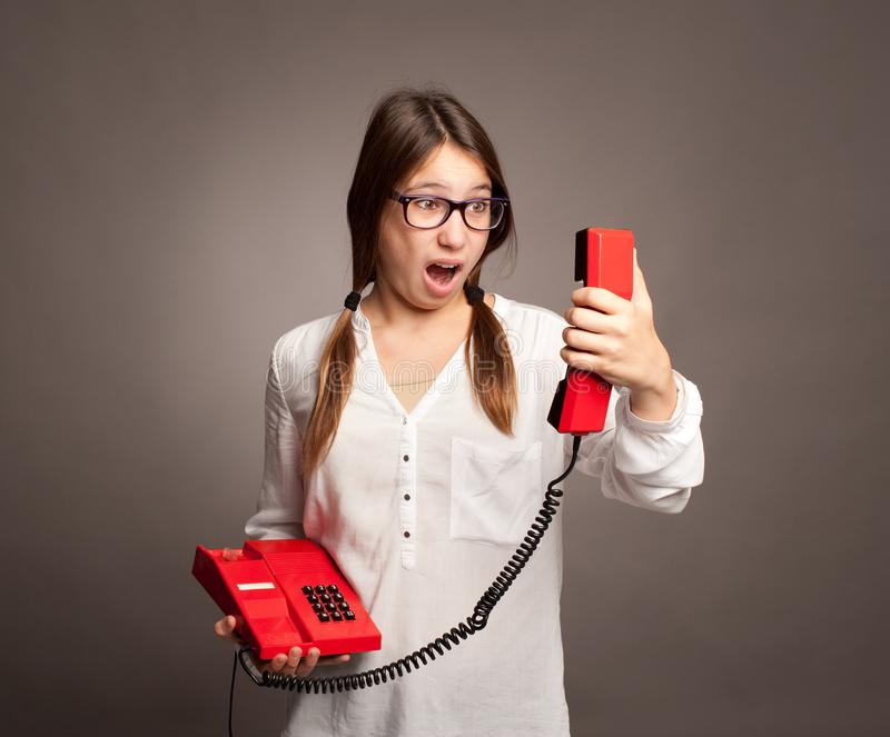 Young girl holding a telephone stock photography