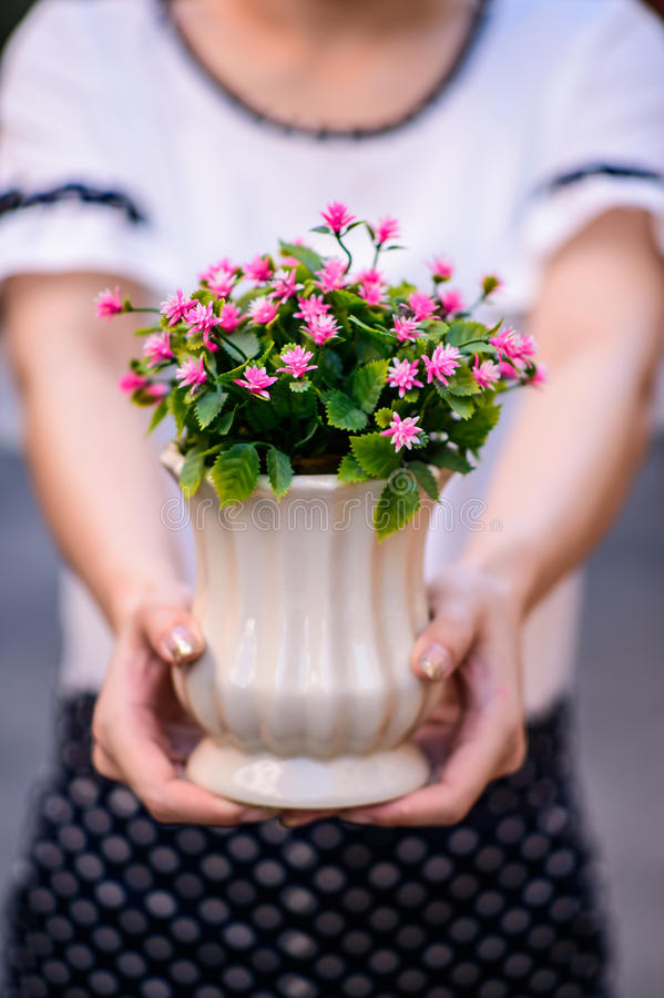 Young girl, holding vase with fresh spring flowers. Close up Young girl, holding vase with fresh spring flowers stock photography