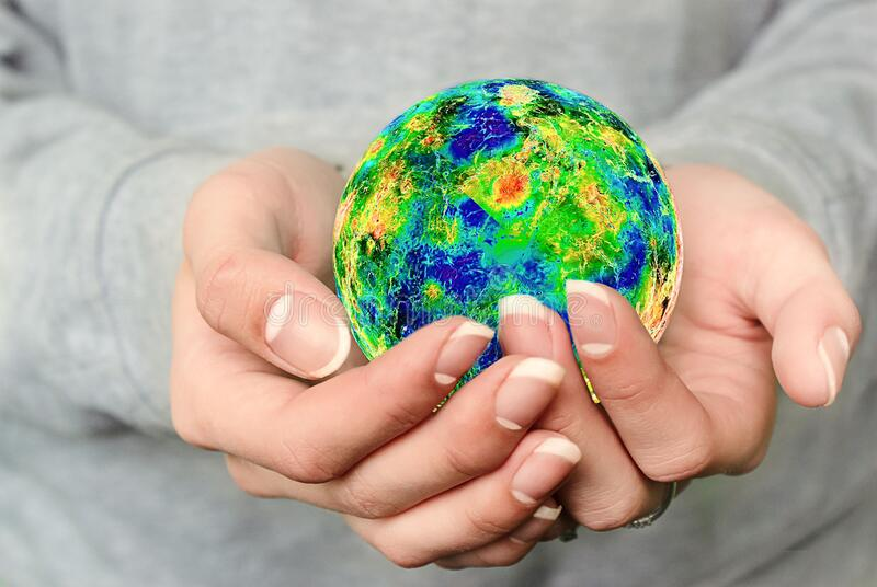 A young girl holds the planet Earth in her hands. The concept of the future. Protection of nature and ecology. Environmental prote royalty free stock photos