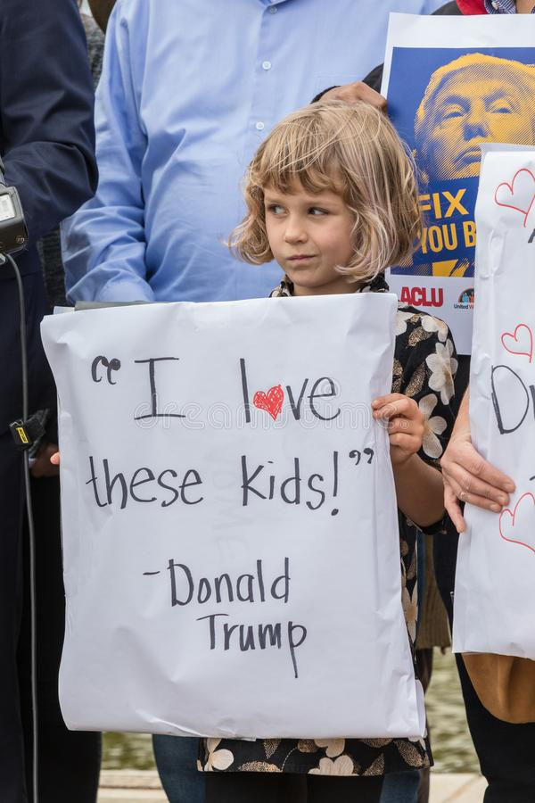 A young girl holds a sign I love these kids quote from Donald Trump. BEVERLY HILLS, CALIFORNIA - MARCH 12, 2018: At the Defend Dreamers Rally hosted by Coalition royalty free stock photography