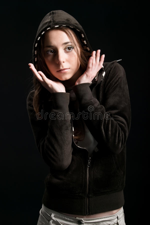 Download Young Girl In Hood With Hand Near Face Stock Photo - Image: 9629646