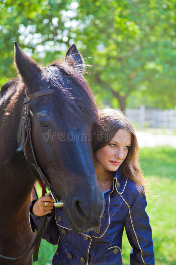 Download Young Girl With A Horse In The Garden. Stock Image - Image: 33908093