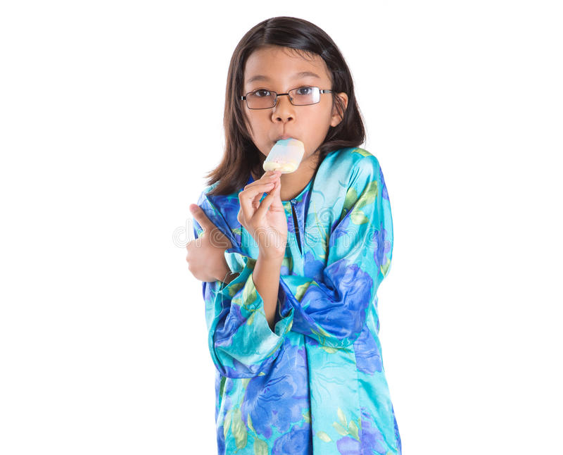 Young Girl With Ice Cream X. Young Malay Asian girl with ice cream over white background stock photos