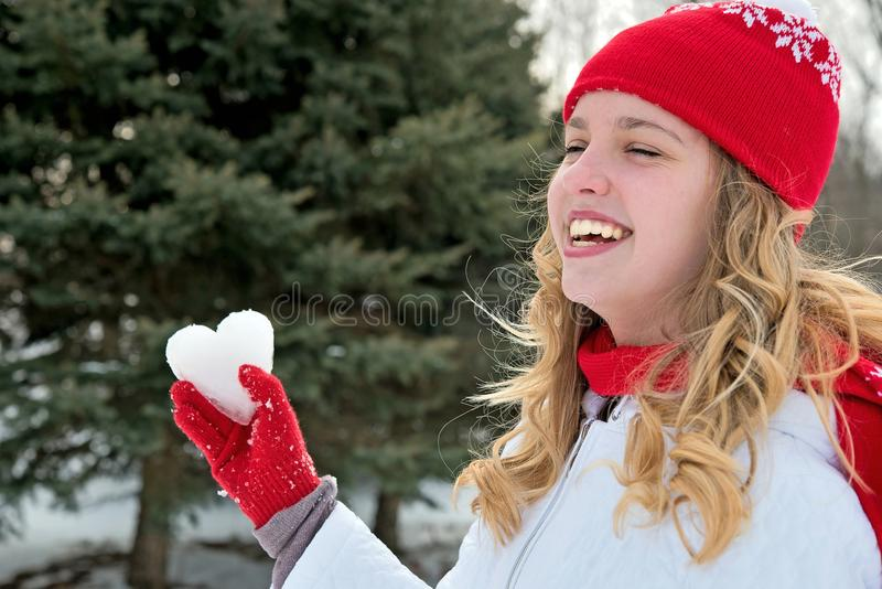 Young girl with ice heart stock photo