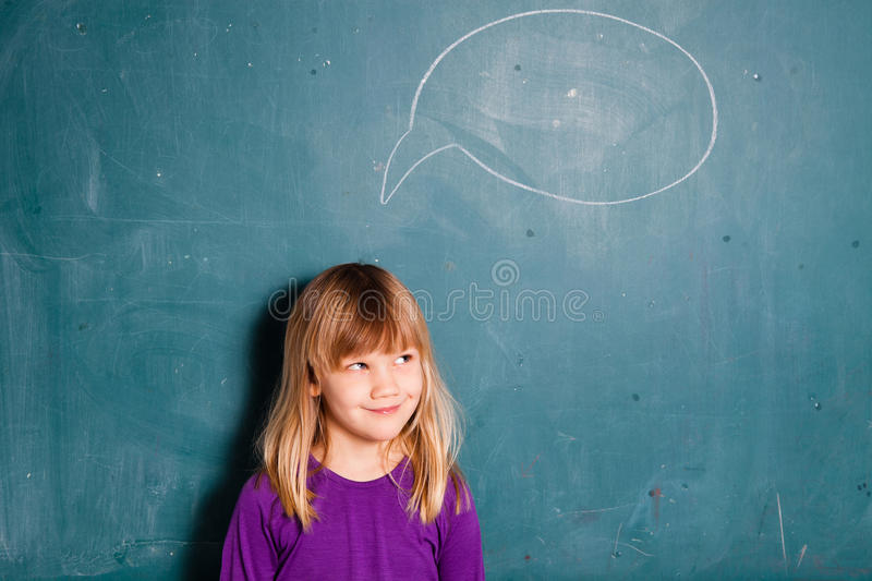 Young girl and idea bubble on chalkboard royalty free stock photo