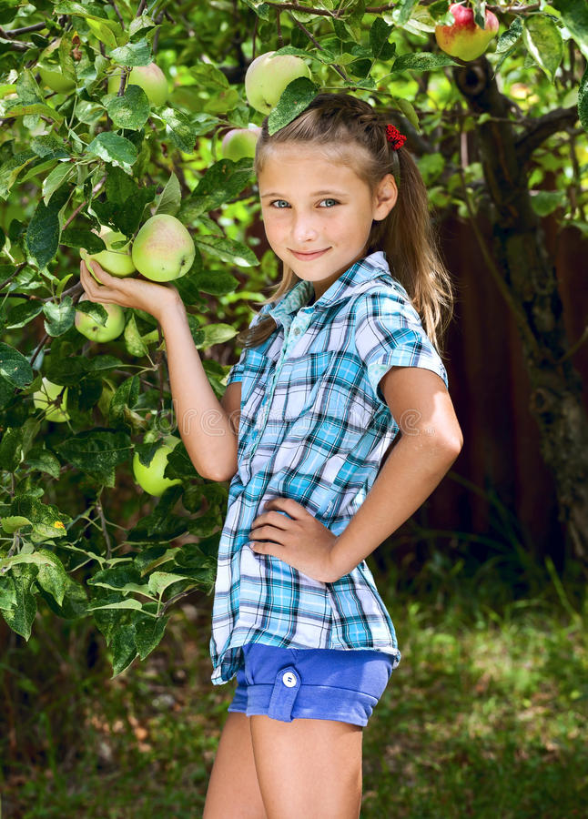 Free Young Girl In An Apple Orchard Stock Image - 35666731