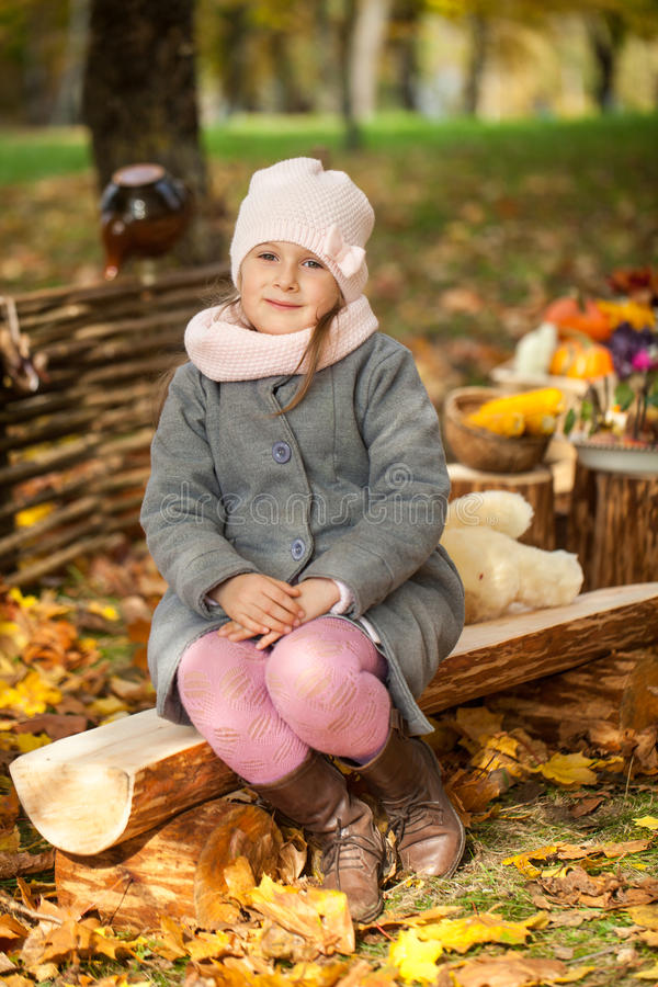 Free Young Girl In Autumn Park On A Wooden Bench Stock Photography - 76503992