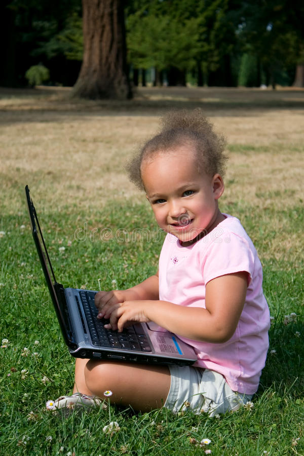 Free Young Girl In Green Grass With Laptop Computer Stock Photos - 10359863
