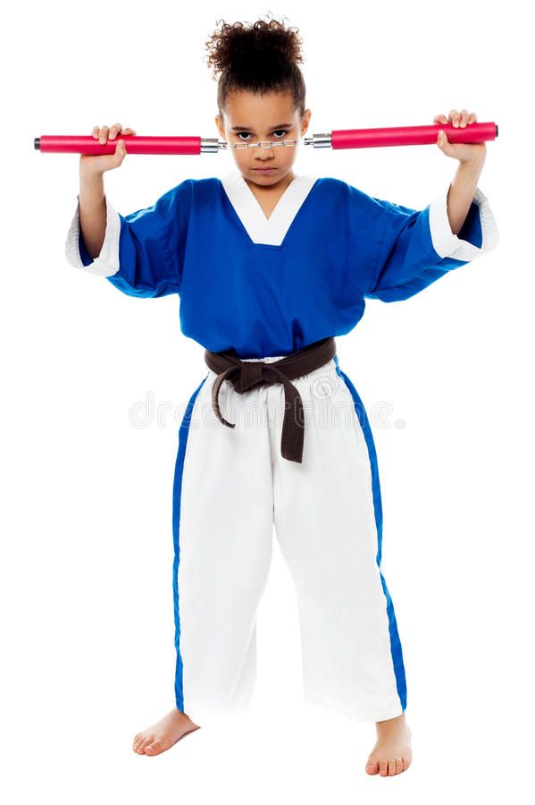 Free Young Girl In Karate Uniform Holding Nunchucks Royalty Free Stock Image - 32848356