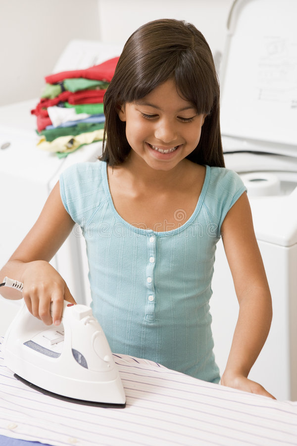 Young Girl Ironing royalty free stock images