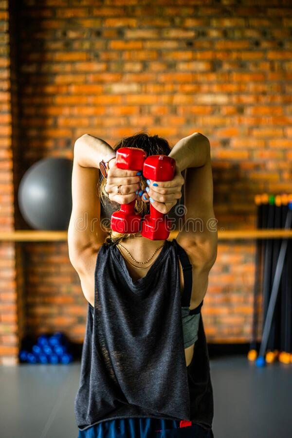 Free Young Girl Is Doing Fitness And Different Exercises In The Gym. Sport Is Health. Many Sports Equipment On  E Background. Themes Of Stock Photo - 187301000