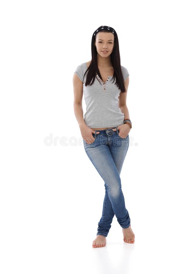 Download Young Girl In Jeans And T-shirt Standing Barefoot Stock Photo - Image: 31218986