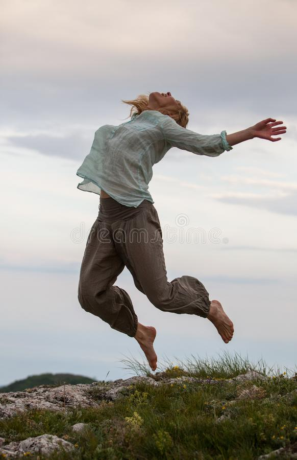 Girl jump stock photo