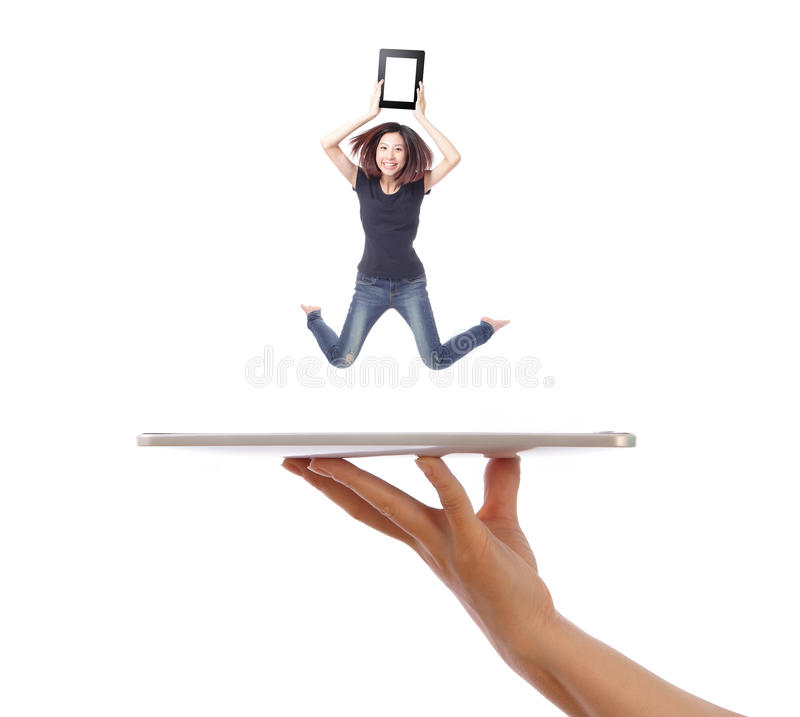 Young girl jump showing tablet pc on people hand stock photos