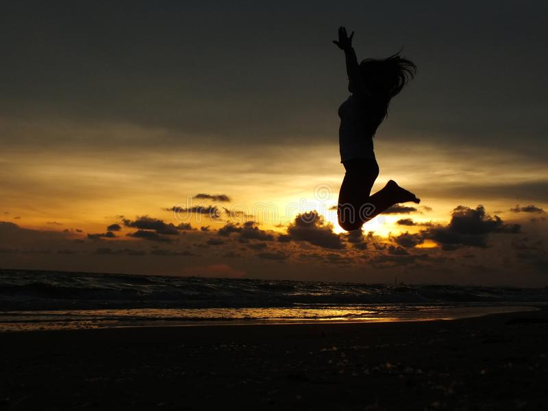 The young girl jumping In the holidays. stock images