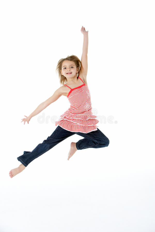 Young Girl Jumping In Mid Air stock images