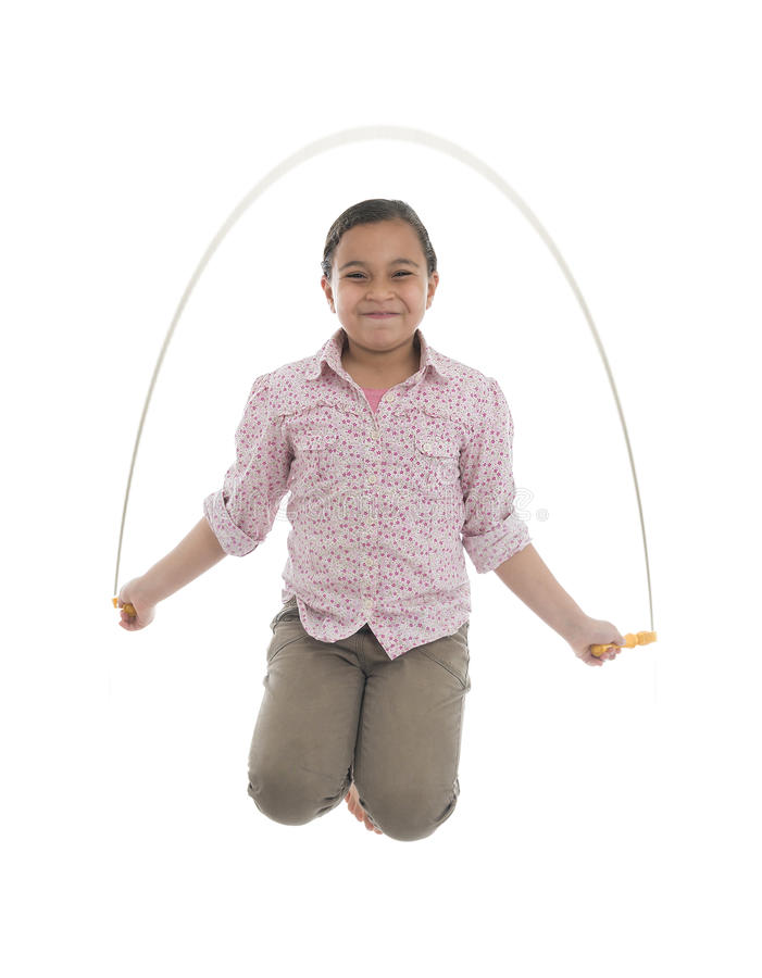 Young Girl Jumping with Skipping Rope royalty free stock image