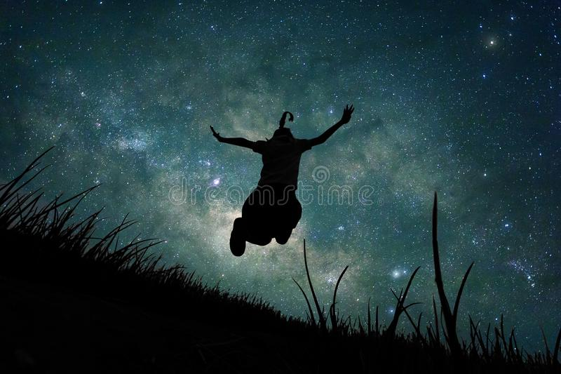Young girl jumping into space, silhouette image royalty free stock photos