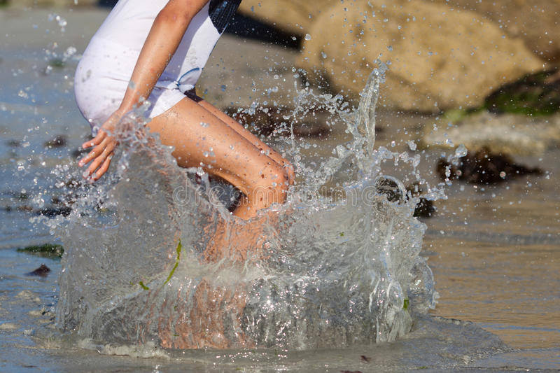 Young girl jumps in the water royalty free stock images