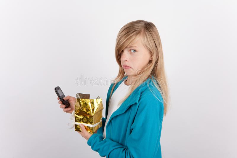 Young girl just unpacked her gift box and very disappointed stock images