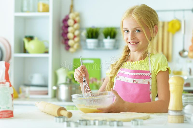 Young girl in the kitchen royalty free stock photography