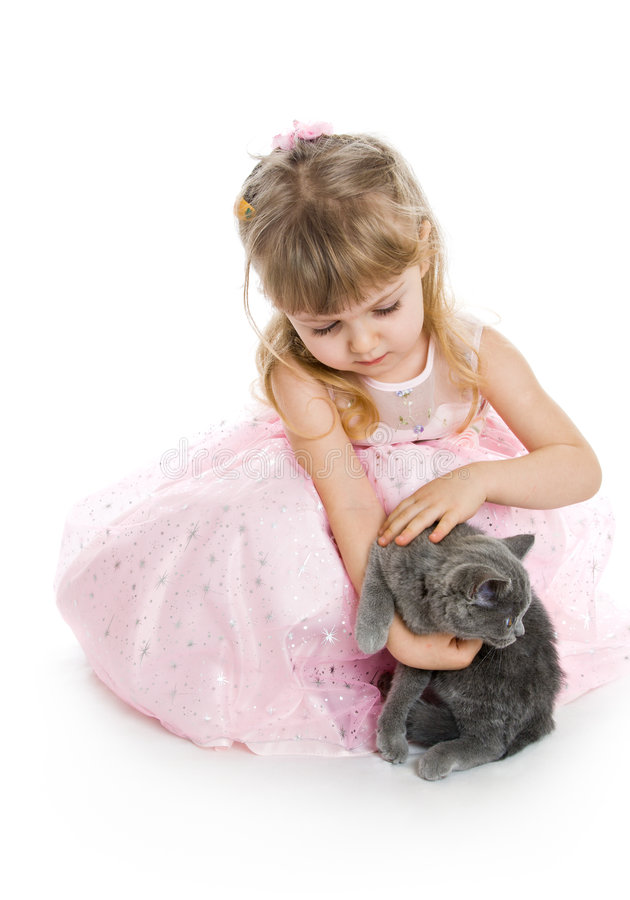 Young girl with kitten stock images