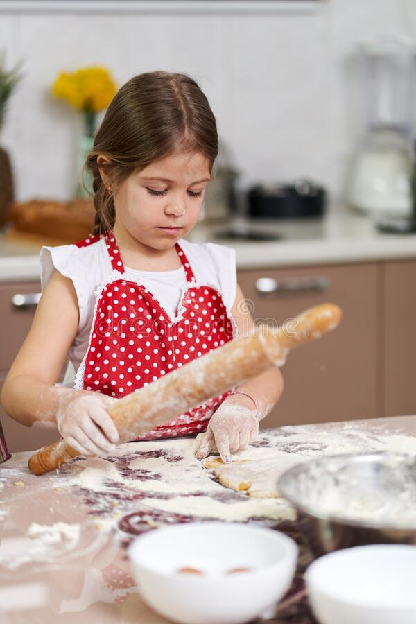 Young girl kneading dough royalty free stock image